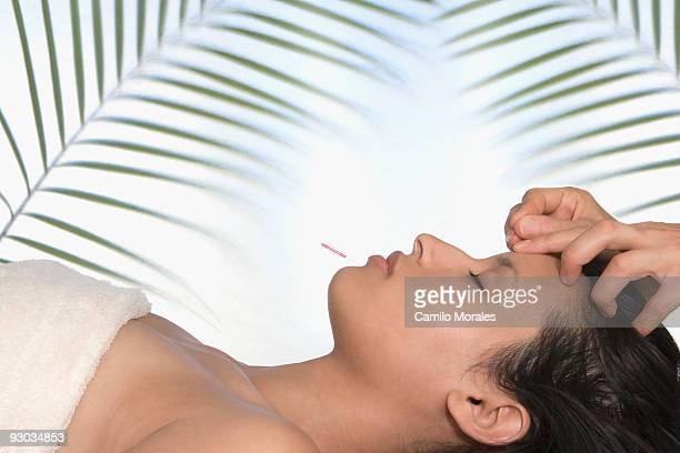 woman having acupuncture therapy on her face - pressure point stock photos and pictures