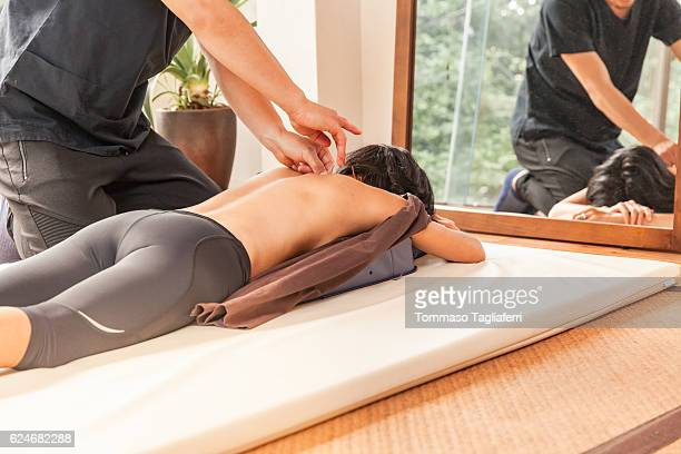 woman having an acupunture session - body massage japan stock pictures, royalty-free photos & images