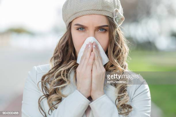 woman having autumn cold - cold virus stock pictures, royalty-free photos & images