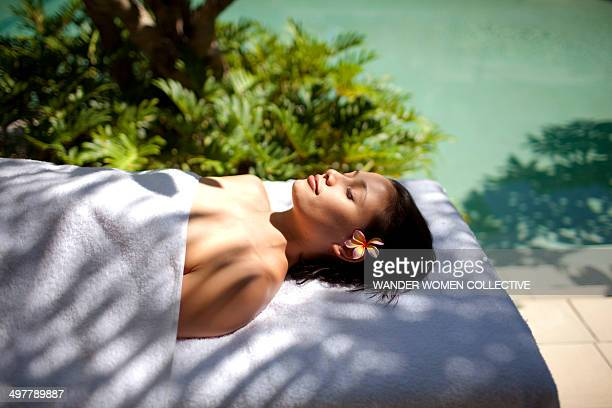 Woman having beauty treatment by a resort pool