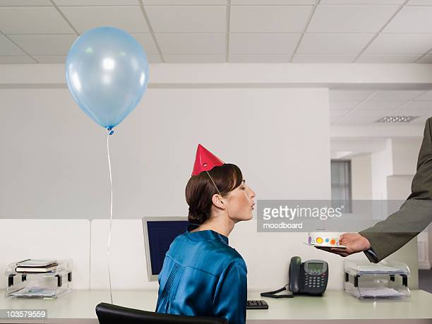 woman having birthday party in office - birthday balloons stock photos and pictures