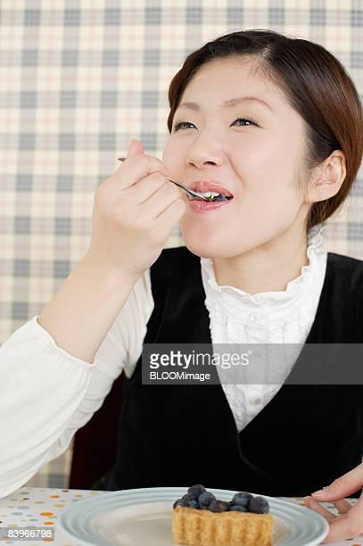 Woman having blueberry pie