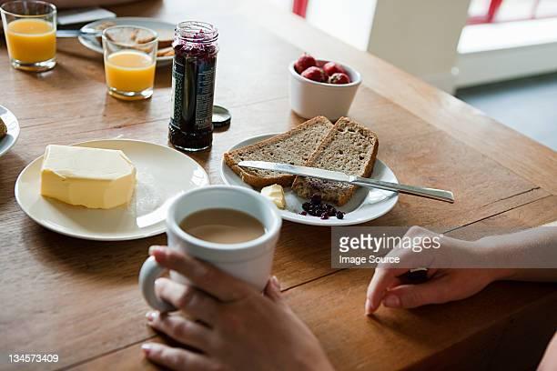 Woman having breakfast, high angle