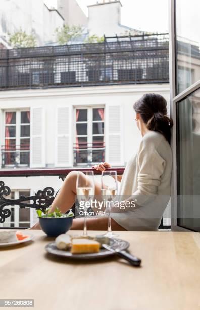 Woman having breakfast in hotel in Paris