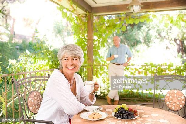 Woman having breakfast outdoors