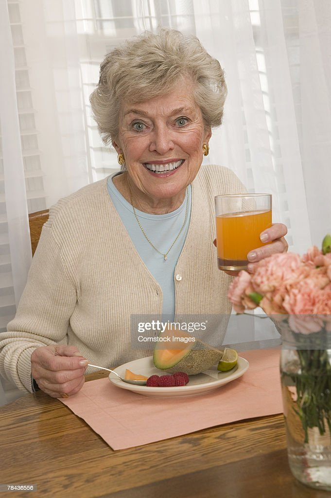 Woman having breakfast : Stockfoto