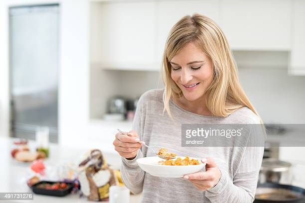 Woman having cereals for breakfast