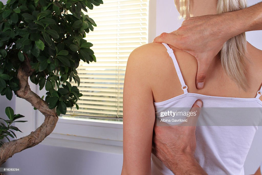 Woman having chiropractic back adjustment close up. : Stock Photo