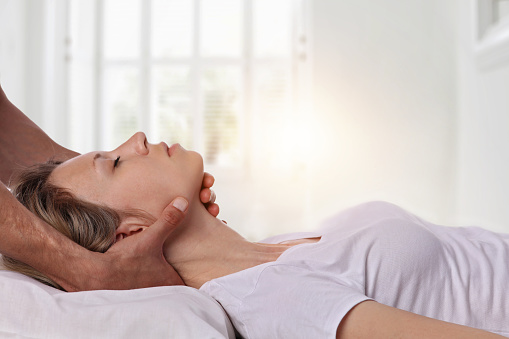 Woman having chiropractic back and neck adjustment. Osteopathy, Acupressure, Alternative medicine, pain relief concept. Physiotherapy, sport injury rehabilitation 681982866