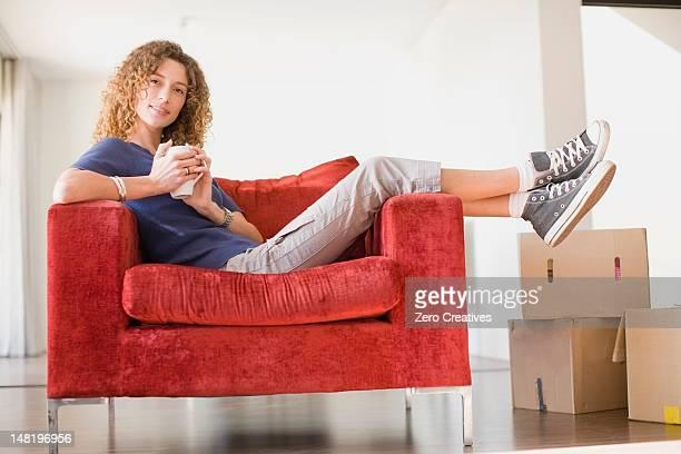 Woman having coffee in armchair
