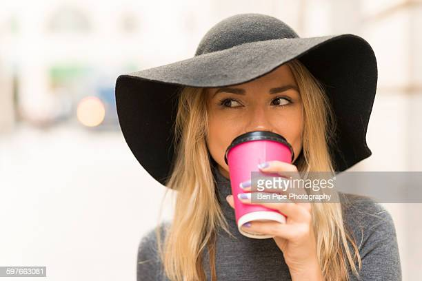Woman having coffee in street