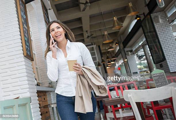 Woman having coffee to go at a coffee shop