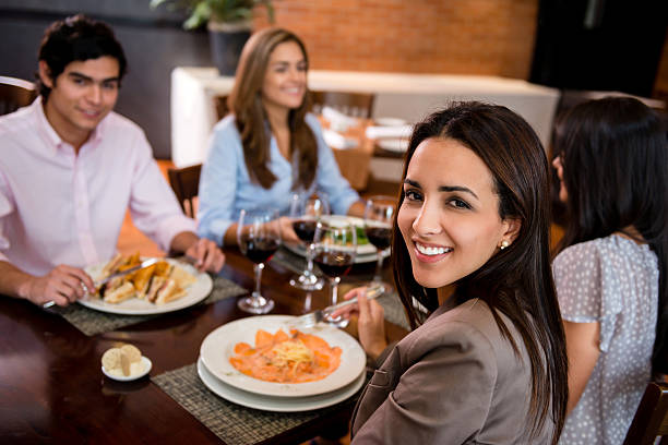 dinner with friends A budget doesn't have to kill your social life if you address the issue early.