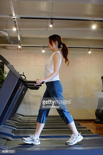 Woman having drink after exercising