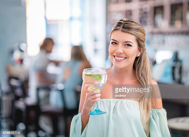 Woman having drinks at a restaurant