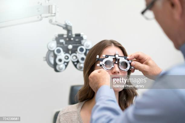 Woman having eye test