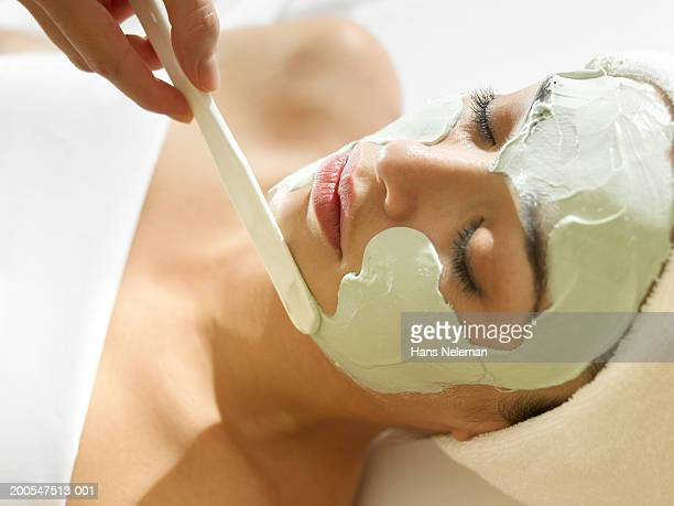 woman having facial, head and shoulders - beauty spa stock pictures, royalty-free photos & images