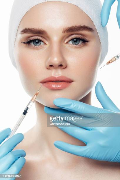 woman having facial injections - botox stock pictures, royalty-free photos & images