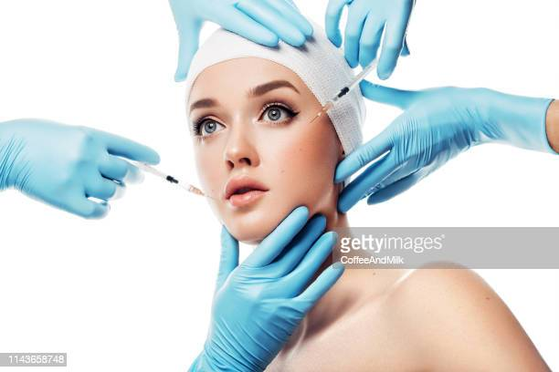 woman having facial injections - human skin stock pictures, royalty-free photos & images