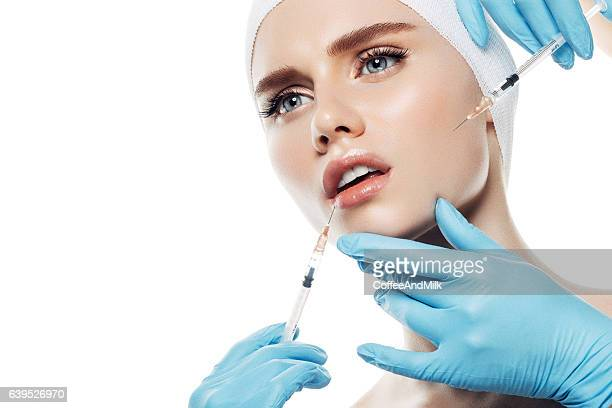 woman having facial injections - studio shot stockfoto's en -beelden