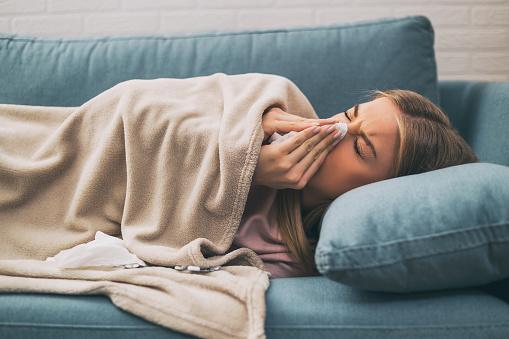 Woman having fever 925714300