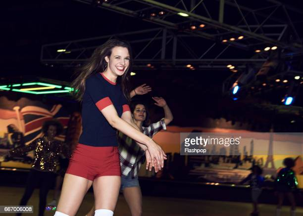 woman having fun at roller disco - roller rink stock photos and pictures