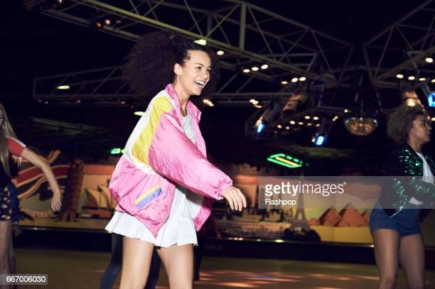 woman having fun at roller disco - mulher saia curta imagens e fotografias de stock