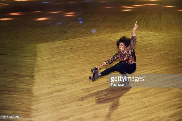 woman having fun at roller disco - showing off stock photos and pictures
