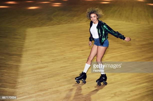 woman having fun at roller disco - kneesock stock pictures, royalty-free photos & images