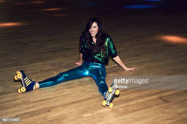 woman having fun at roller disco - roller skating stock photos and pictures