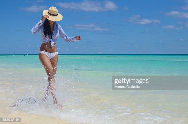 woman having fun at the beach, cayo coco, cuba. - radicella stock photos and pictures