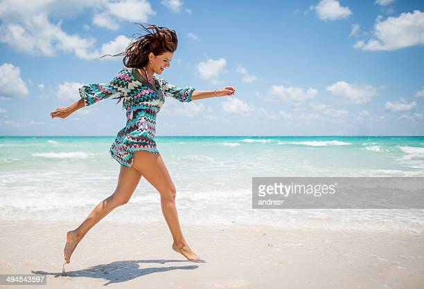 woman having fun at the beach - gulf coast states stock pictures, royalty-free photos & images