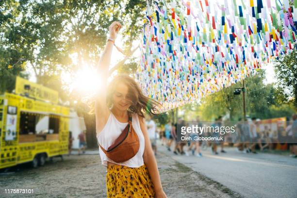 woman having fun on music festival in summer - music festival stock pictures, royalty-free photos & images