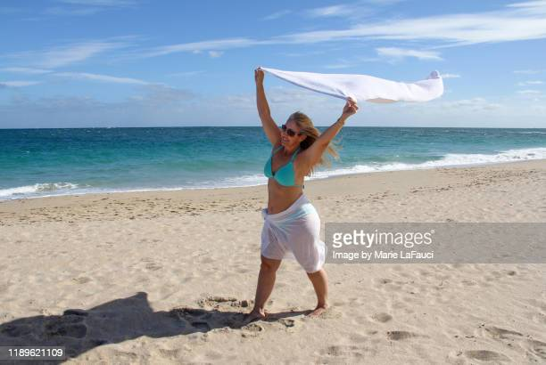 woman having fun on the beach - marie lafauci stock pictures, royalty-free photos & images