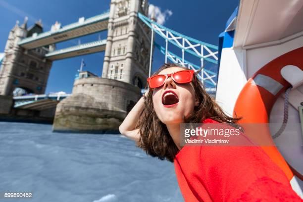 woman having fun - london bridge england stock pictures, royalty-free photos & images