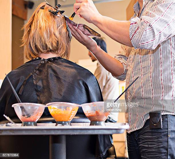 woman having hair colored in salon - hair colourant stock pictures, royalty-free photos & images