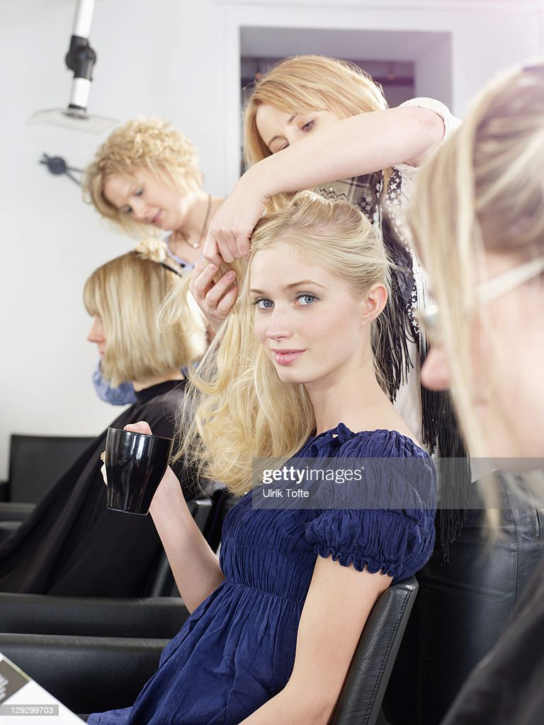 Woman having hair cut in salon : Stock Photo