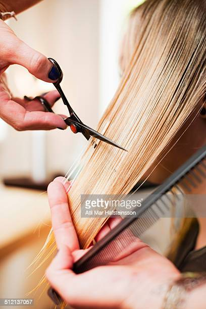Woman having haircut in salon