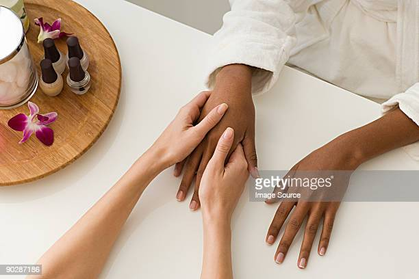 Woman having hands massaged