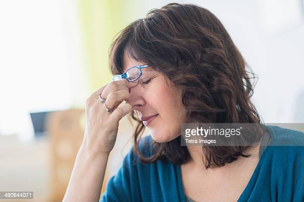 woman having headache, jersey city, new jersey, usa - long nose stock photos and pictures