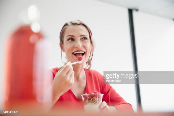 Woman having healthy lunch break in office