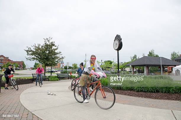 Woman having her bachelorette party costumed on a bicycle