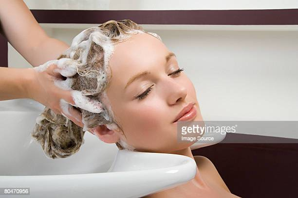 A woman having her hair washed