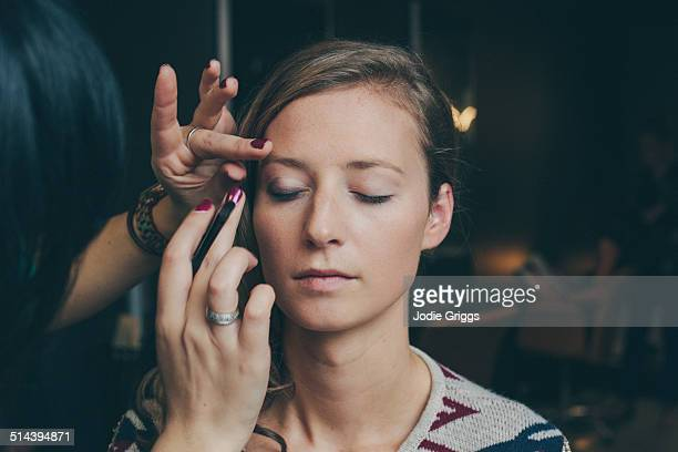 Woman having her make up done by a make up artist