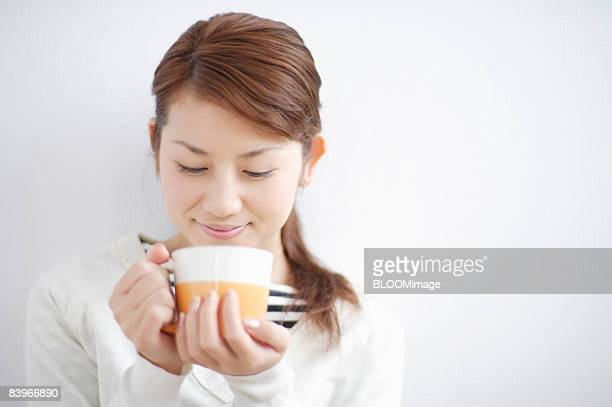 Woman having hot drink