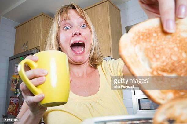 Woman having hot toast