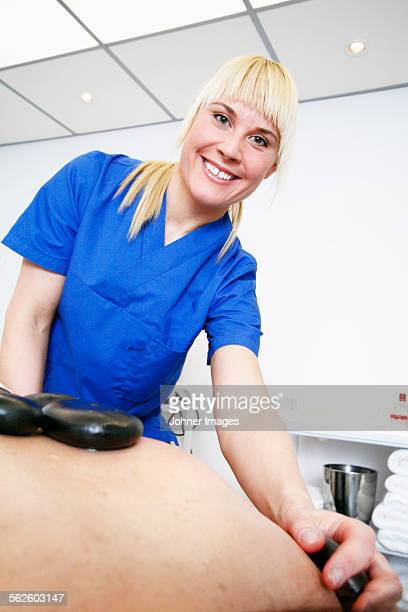 Woman having lastone therapy