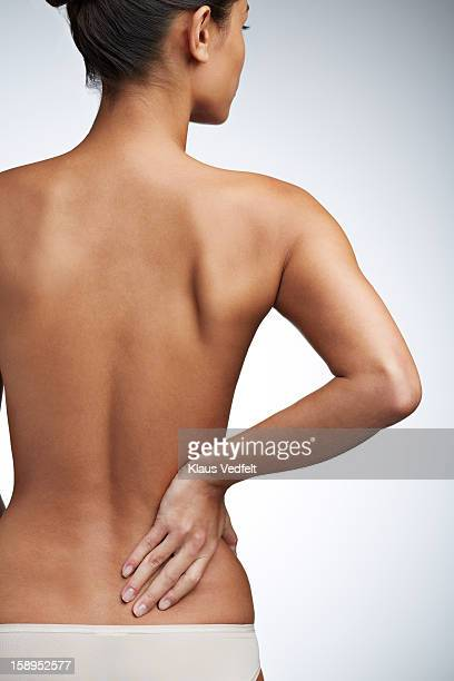 Woman having lower back pain (rear view)