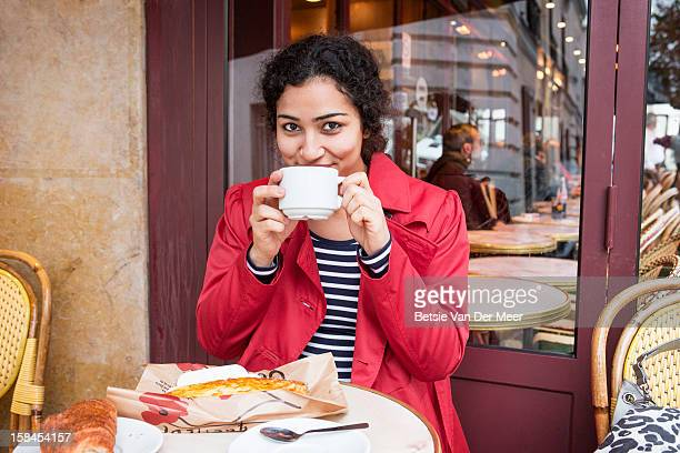 woman having lunch break in parisian cafe. - french cafe stock photos and pictures