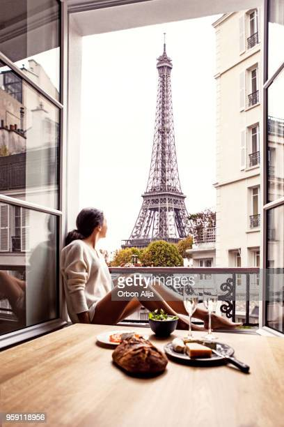 woman having lunch in hotel in paris - balcony stock pictures, royalty-free photos & images